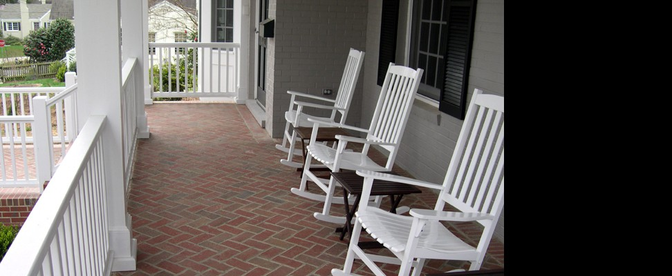 Herringbone pattern brickwork makes this porch more inviting