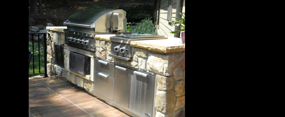 Built-in cook station keekps this client outdoors enjoying his hardscape more