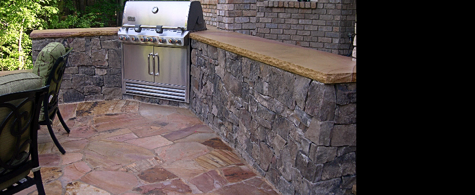 This built-in cooking center features Tennesse capstone serving area and a Tennessee flagstone patio