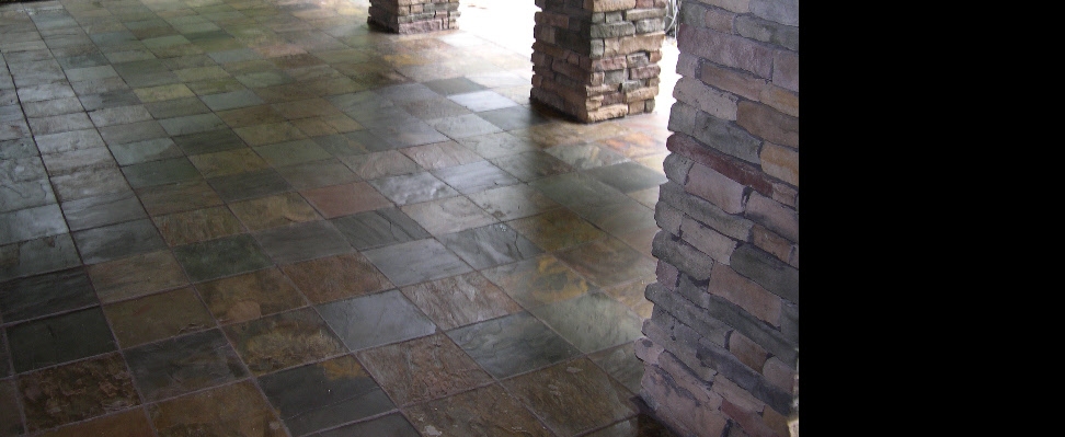 The covered portion of this large patio is 12'' stone tiles with dark dyed mortar joints