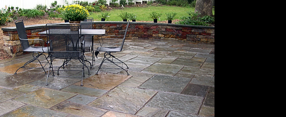 This is an example of full-color variegated Pennsylvania pattern flagstone with dark-dyed grout joints.  Construction is over a 4'' concrete slab with approximately 1/2'' mortar under each 1'' thick flagstone