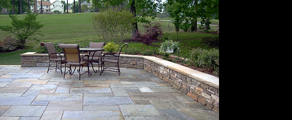 A 2,000 square foot Pennsylvania flagstone pattern terrace with dark-dyed mortar joints.  This flagstone has been sealed with a low-gloss color-enhancing acrylic sealer.