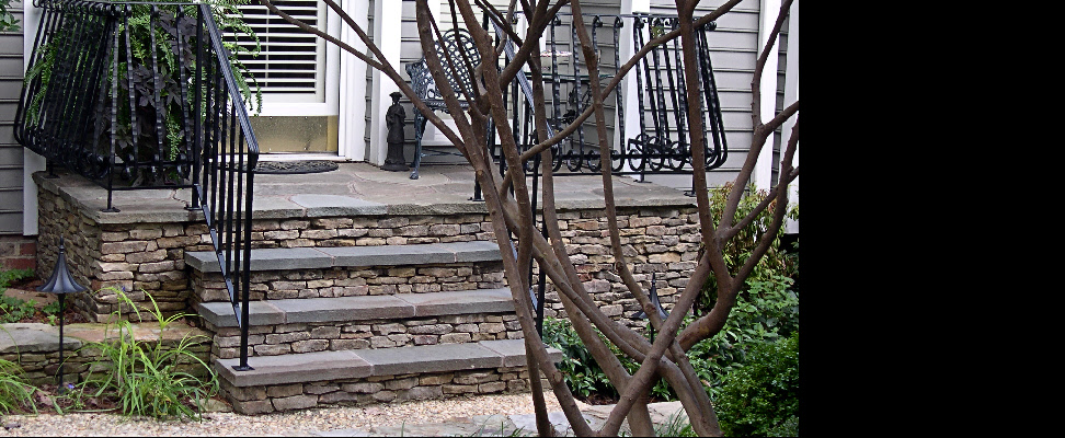 This masonry porch and steps replaced a wooded deck entry to an elegant north Raleigh townhome