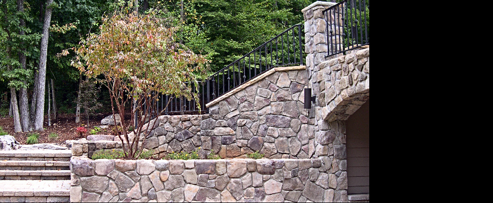 Synthetic stone walls are an integral part of this extensive landscape