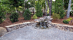 Patio with Stream and Wall Waterfall