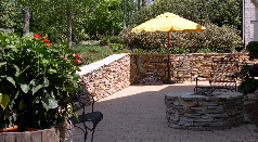 Natural stone wall and gas firepit